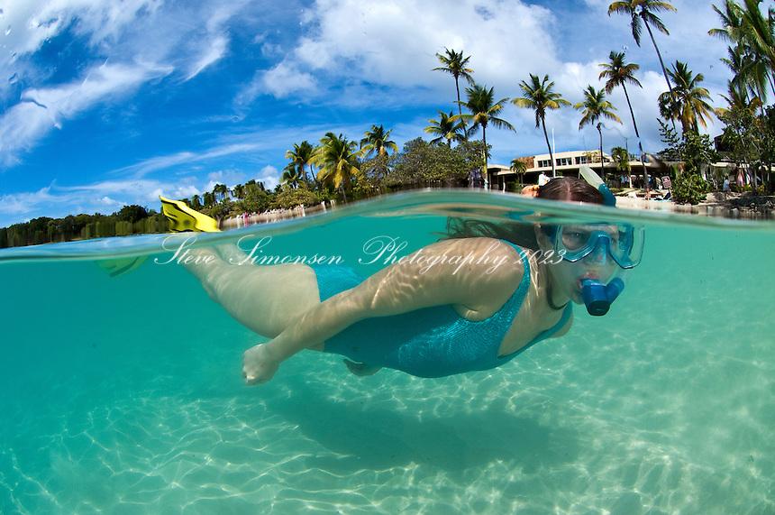 Split level image of a snorkeler<br /> Caneel Bay Resort<br /> St. John, U.S. Virgin Islands