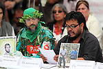 Raul Romero (L) reads an statement during the dialogue with members of the National Movement for Peace with Justice and Dignity (MPJD) in the Alcazar del Castillo de Chapultepec venue in Mexico City, May 28. 2012. Sicilia and the mothers of disappeared people demanded peace to Mexico and the punishment of the authorities linked to the organized crime in Mexico. Photo by Heriberto Rodriguez