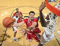 Dec. 07, 2010; Charlottesville, VA, USA;  Radford Highlanders forward Tolga Cerrah (41) shoots the ball next to Virginia Cavaliers center Assane Sene (5) during the game at the John Paul Jones Arena. Virginia won 54-44. Mandatory Credit: Andrew Shurtleff