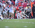 Georgia fullback Alexander Ogletree (46) vs. Ole Miss linebacker Serderius Bryant (14) at Sanford Stadium in Athens, Ga. on Saturday, November 3, 2012.