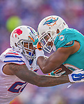 14 September 2014: Buffalo Bills free safety Duke Williams goes head to head with Miami Dolphins wide receiver Brandon Gibson after a 10 yard reception play in the fourth quarter at Ralph Wilson Stadium at Ralph Wilson Stadium in Orchard Park, NY. The Bills defeated the Dolphins 29-10 to win their home opener and start the season with a 2-0 record. Mandatory Credit: Ed Wolfstein Photo *** RAW (NEF) Image File Available ***