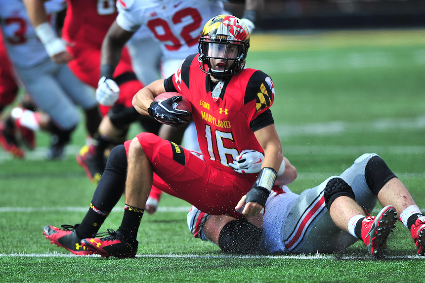 Terrapins'  CJ Brown is sacked in the first half. Ohio State trounced Maryland 52-24 during a game at the Capital One Field in Byrd Stadium, College Park, MD on Saturday, October 3, 2014.  Alan P. Santos/DC Sports Box