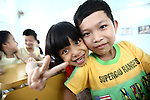 A girl flashes the peace sign while posing with her friend for a photograph at a center for children who have been affected by dioxin exposure in Hoa Nhon village, near Da Nang, Vietnam. The Da Nang Association of Victims of Agent Orange/Dioxin says that more than 1,400 children around the city suffer from mental and physical disabilities because of dioxin exposure, a legacy of the U.S. military's use of Agent Orange and other herbicides during the Vietnam War more than 40 years ago. About 60 children attend the Hoa Nhon center each day. Many have mental disabilities, while others cannot hear or speak. It usually takes a year for a new child to interact with other children and make friends, says Phan Thanh Tien, the association's president. The Vietnam Red Cross estimates that 3 million Vietnamese suffer from illnesses related to dioxin exposure, including at least 150,000 people born with severe birth defects since the end of the war. The U.S. government is paying to clean up dioxin-contaminated soil at the Da Nang airport, which served as a major U.S. base during the conflict. But the U.S. government still denies that dioxin is to blame for widespread health problems in Vietnam and has never provided any money specifically to help the country's Agent Orange victims. May 29, 2012.