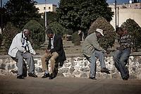 Men play checkers in Asmara, Eritrea.