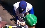 Paolo Diego Salcido photographs Major League Baseball great Josh Hamilton of the Texas Rangers patiently autographs young and old fan's baseballs at Oakland A's game.