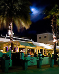 Kralendijk, Bonaire, Netherland Antilles -- The moon illuminates one of the many waterfront restaurants and bars in Kralendijk.