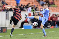 Houston, TX - Friday December 9, 2016: Jeremy Kelly (29) of the North Carolina Tar Heels blocks a kick by Tanner Beason (3) of the Stanford Cardinal at the NCAA Men's Soccer Semifinals at BBVA Compass Stadium in Houston Texas.