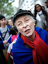 A woman dressed in the color of the French flag cannot contain her joy.