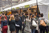 Foodies enjoy the offerings at the UrbanSpace Garment District outdoor market on Broadway in New York on Wednesday, October 1, 2014. The popular temporary food fair, on Broadway in the Garment District, brings an assortment of restaurants providing an outdoor dining experience attracting hungry office workers, shoppers and tourists. UrbanSpace runs a number to temporary pop-ups in the city including Madison Sq. Eats, Broadway Bites and most famously the long-running Union Square Holiday Market..(© Richard B. Levine)