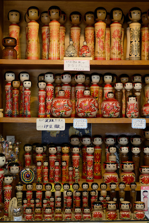 """Kokeshi"" wooden dolls on sale in a shop. Ginzan Onsen, Yamagata Prefecture, Japan, April 12, 2016. Once a sliver-mining town, Ginzan Onsen in Yamagata Prefecture is now one of Japan's best-known and most picturesque hot spring resorts. Its Taisho-period architecture and retro atmosphere is said to have been an inspiration for Hayao Miyazaki's Oscar-winning animated film, Spirited Away."