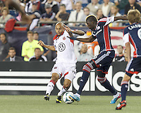 D.C. United midfielder Kyle Porter (19) on defense. In a Major League Soccer (MLS) match, the New England Revolution (blue) tied D.C. United (white), 0-0, at Gillette Stadium on June 8, 2013.