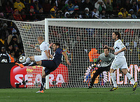 Clint Dempsey attempts to turn a shot on goal. The United States came from a 2-0 halftime deficit to Slovenia to earn a 2-2 draw their second match of play in Group C of the 2010 FIFA World Cup.