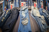 Denim jeans at American Eagle Outfitters in the Herald Square shopping district in New York on Thanksgiving Day, Thursday, November 26, 2015. Many retailers opened their doors on Thanksgiving day including some in Herald Square hoping to capture the dollars from shoppers after the parade. (© Richard B. Levine)