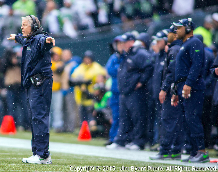 Seattle Seahawks head coach Pete Carroll signals to his defense  during the NFC Championship game against the Green Bay Packers at CenturyLink Field in Seattle, Washington on January 18, 2015.  The Seattle Seahawks beat the Green Bay Packers in overtime 28-22 for the NFC Championship Seattle.  ©2015. Photo by Jim Bryant, All Rights Reserved.