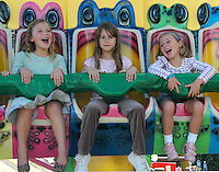 Children ride the Frog Hopper during the 8th Annual 'Mattel Party on the Pier' at Pacific Park on Sunday