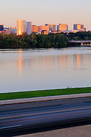 An early morning view of Rosslyn, Virginia, across Ohio Drive traffic and the Potomac River.