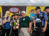 Mar 20, 2016; Gainesville, FL, USA; NHRA top fuel driver Brittany Force celebrates with family members Courtney Force , Louie Force , Jacob Hood and John Force after winning the Gatornationals at Auto Plus Raceway at Gainesville. Mandatory Credit: Mark J. Rebilas-USA TODAY Sports
