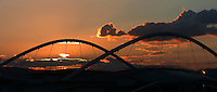 Aug 16, 2004 - Athens, Greece - The sun sets behing the Olympic stadium in Athens, Greece Monday evening. The Olympic flame burns at right. (ag 2004). .(Credit Image: © Alan Greth/ZUMA Press)