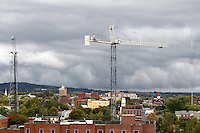 The downtown cityscape with construction crane and ominous weather over Charlottesville, VA. Photo/Andrew Shurtleff