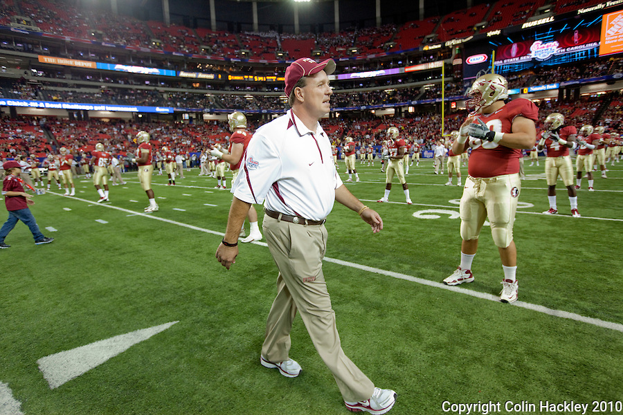 ATLANTA, AG 12/31/10-FSU-SC FB10 CH-Florida State Head Coach Jimbo Fisher walks among his players prior to the game against South Carolina Friday at the Chick-fil-A Bowl in Atlanta..COLIN HACKLEY PHOTO