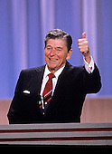 United States President Ronald Reagan acknowledges the cheers of the delegates to the 1988 Republican National Convention at the Louisiana Superdome in New Orleans, Louisiana on August 15, 1988. <br /> Credit: Arnie Sachs / CNP