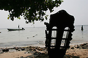 "A guitar sits on a beach as it's owner awaits a canoe to take him back to his own island, after ""school closing"" festivities on Han Island, Carteret Atoll, Papua New Guinea, on Sunday, Dec. 10, 2006."
