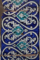 Detail of majolica tiling, Kurinish Khana or Throne Room, 1804-06, Kukhna Ark, Khiva, Uzbekistan, pictured on July 5, 2010, in the afternoon. The Kukhna Ark is the original home of the Khans. Although its foundations are 5th century, most of the complex is 19th century. The Kurinish Khana (throne room), 1804-06, with its arcade or iwan, is the place where audiences were held in the open air in summer and enclosed by a yurt in winter. Khiva, ancient and remote, is the most intact Silk Road city. Ichan Kala, its old town, was the first site in Uzbekistan to become a World Heritage Site(1991). Picture by Manuel Cohen.