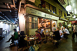 Customers enjoy the outside ambience of a  restaurant inside the old market area of Shimokitazawa, Setagaya Ward, Tokyo, Japan..Photographer: Robert Gilhooly