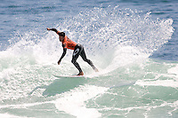 Brazilian Adriano De Souza banks of the inside section during round of 96 of the 2010 US Open of Surfing in Huntington Beach, California on August 4, 2010.