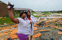 Gary Cosby Jr./Decatur Daily   Chiquita Thomas and Genevieve Rich give thanks to God for their safety after high winds from a severe thunderstorm blew apart Rich's garage on Winfred Rd. in the Tanner community south of Athens.