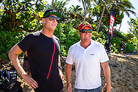 PIPELINE, Oahu, Hawaii (Tuesday, December 10, 2013) Mick Fanning (AUS) and former pro surfer Michael Lowe (AUS).   - The 2013 Billabong Pipe Masters in Memory of Andy Irons resumed today in six foot (2 metre) barrels and there was no shortage of drama in the ASP World Title race between Mick Fanning (AUS), 32, and Kelly Slater (USA), 41. There was also a shift in the Vans Triple Crown of Surfing Rankings as well as qualification developments for the 2014 WCT.<br /> <br /> The Billabong Pipe Masters represents the pinnacle of the 2013 ASP World Championship Tour, deciding the ASP World Title, Vans Triple Crown of Surfing, and final slots for 2014 ASP WCT qualification.<br /> <br /> Mick Fanning, two-time ASP World Champion and current No. 1, dominated his Round 3 clash with wildcard Kaimana Jaquias (HAW), 20, but unexpectedly erred in his three-man Round 4 heat against John John Florence (HAW), 21, and Nat Young (USA), 22. A last minute paddle battle with heat leader Florence in the closing seconds of the match took him from second to third and now pits him against one of the best Pipeline surfers in the world: C.J. Hobgood (USA), 34, in Round 5. Meanwhile, Slater skips Round 5 and heads straight to the Quarterfinals after his Round 4 win.<br /> <br /> Clearly disappointed with his misstep, Fanning couldn&rsquo;t leave the beach fast enough and wasn&rsquo;t prepared to talk about how this affects his approach to the final day of competition.<br /> <br /> Kelly Slater was electric in his bid for a historic 12th ASP World Title, earning the high heat-totals of both Round 3 and 4. Slater tore past Mitch Crews (AUS), 23, with a 17.66 out of 20 heat total for incredible Pipeline and Backdoor barrels and backed up the performance with a 17.50 out of 20 in Round 4.<br /> Photo: joliphotos.com