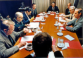 United States President Ronald Reagan reviews the Beirut situation with his National Security Advisors in a Sunday morning, October 23, 1983 meeting in the Situation Room.  Clockwise from left are: Robert McFarlane, National Security Advisor-designate (back to camera); Edwin Meese Counsellor to the President; General John W. Vessey, Chairman of the Joint Chiefs of Staff; Caspar Weinberger, Secretary of Defense; Vice President George H.W. Bush; President Reagan; George Shultz, Secretary of State; John McMahon, Deputy Director of the Central Intelligence Agency (CIA); and James A. Baker III, White House Chief of Staff..Mandatory Credit: Bill Fitz-Patrick - White House via CNP