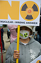 April 10, 2011 - A women holds a placard during an anti-nuclear protest at Koenji Chuo park in Koenji, Tokyo, Japan..According to the organisers 15,000 attended the protest more conservative estimates put the number at 5000. (Photo by B.Meyer-Kenny/2.0 images)