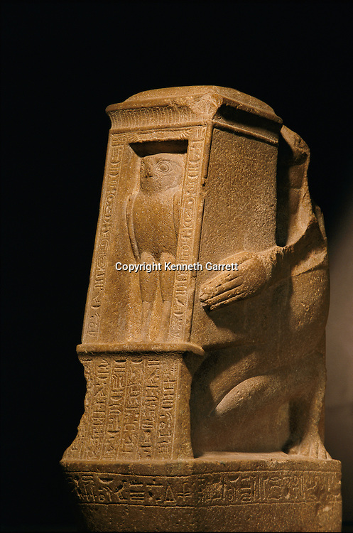 Headless statue of Sebty made of quartzite, New Kingdom