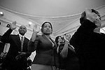 Friday, April 20,  2007, New York, New York.. 100 people were sworn in as US citizens today at the New York Historical Society located at 170 Central Park West.. Mary Rodrigo, center, formerly of Sri Lanka, raises her hand for the citizenship oath.