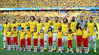 The Brazil team line up as they sing their national anthem before kick off