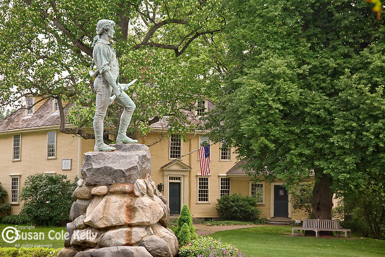 Minuteman statue (by Henry H. Kitson) and the Buckman Tavern (circa 1704-1710) at Lexington Green, Lexington, MA, USA