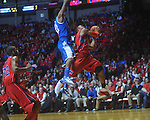 Ole Miss guard Dundrecous Nelson (5) shoots as Kentucky's Brandon Knight (12) defends at the C.M. &quot;Tad&quot; Smith Coliseum in Oxford, Miss. on Tuesday, February 1, 2011. Ole Miss won 71-69.
