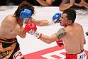 (L to R) Tomonobu Shimizu (JPN), Hugo Cazares (Mex), AUGUST 31, 2011 - Boxing : Tomonobu Shimizu of Japan hits Hugo Cazares of Mexico during the WBA Super fly weight title bout at Nippon Budokan, Tokyo, Japan. Tomonobu Shimizu of Japan won the fight on points after twelve rounds. (Photo by Yusuke Nakanishi/AFLO SPORT) [1090]