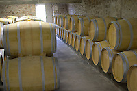 Oak barrel aging and fermentation cellar. Chateau Richelieu, Fronsac, Bordeaux, France