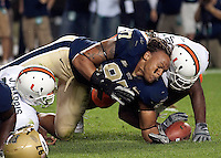Pitt defensive end Jabaal Sheard goes after the football without a helmet. The Miami Hurricanes defeated the Pittsburgh Panthers 31-3 at Heinz Field, Pittsburgh, Pennsylvania on September 23, 2010.