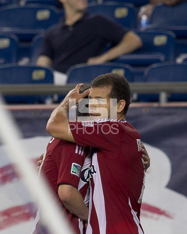 Chivas USA forward Alejandro Moreno (15) celebrates his goal with teammates. In a Major League Soccer (MLS) match, Chivas USA defeated the New England Revolution, 3-2, at Gillette Stadium on August 6, 2011.
