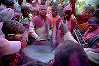 A procession with a huge drum at Barsana during lathmar holi festival, Uttar Pradesh, India on the day of Lathmar holi. Lathmar holy is celibrated 7 days before the actual holi day.