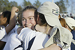 05 December 2004: Lizzie Reed (left) and Annie Schefter (right) celebrate with a hug. Notre Dame defeated UCLA 4-3 on penalty kicks after the game ended in a 1-1 overtime tie at SAS Stadium in Cary, NC in the championship match in the 2004 NCAA Division I Women's College Cup...