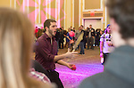 Juggler Tony Steinbach, of Columbus, Ohio, entertains Ohio University students and their siblings while they wait in line for actvities at the Sibs Carnival during Siblings Weekend on February 6, 2016. Photo by Emily Matthews
