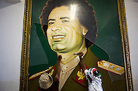 Two men vanadalise a portrait of Gaddafi at the womens police academy in Tripoli which they took over a few hours previously. After a six month revolution, rebel forces finally managed to break into Tripoli and have taken control of Bab al-Aziziyah, Col Gaddafi's compound and residence. Few remain that are loyal to Gaddafi in the city; it is seeming that the 42 year regime has come to an end. Gaddafi is currently on the run.