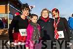 Katie, Marie and Annie O'Sullivan with Kathleen O'Donoghue (all from Firies), pictured at the Santa Fun Run, in aid of Barretstown, starting from the Tralee Bay Wetlands, on Sunday last.