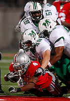 Ohio State running back Jaamal Berry (4) gets tackled by Marshall defenders during the fourth quarter of the NCAA football game at Ohio Stadium on Thursday, September 2, 2010. (Photo by Jonathan Quilter)