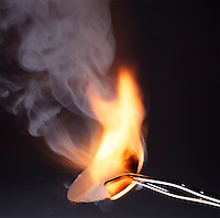 PHOSPHORUS (WHITE) BURSTS INTO FLAMES<br /> (7 of 7)<br /> Exothermic Reaction Between Oxygen and Phosphorus<br /> Finely divided white phosphorus, deposited on a piece of filter paper by evaporation of a carbon disulfide solution of P4, bursts into flames on contact with air. The laminar flow of smoke becomes turbulent as it diffuses in the air.