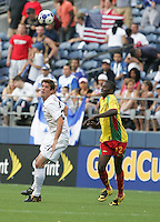 Brad Evans (21) heads the ball against Denron Daniel (12). USA defeated Grenada 4-0 during the First Round of the 2009 CONCACAF Gold Cup at Qwest Field in Seattle, Washington on July 4, 2009.